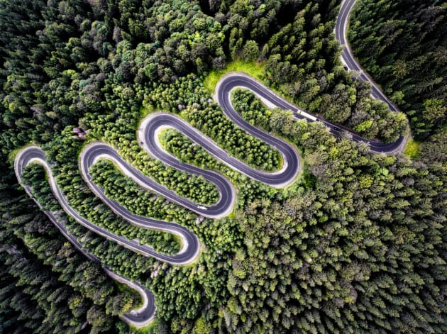 Infinity Road to Transylvania by Calin Stan. The true beauty and winding nature of Cheia (DN1A), a road in Romania that leads you into Transylvania, can only be shown through aerials as depicted here.