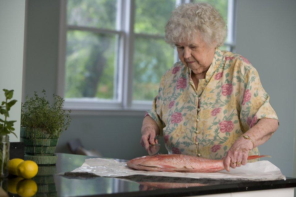 Fish Food Free Stock Photo An Elderly Woman Preparing
