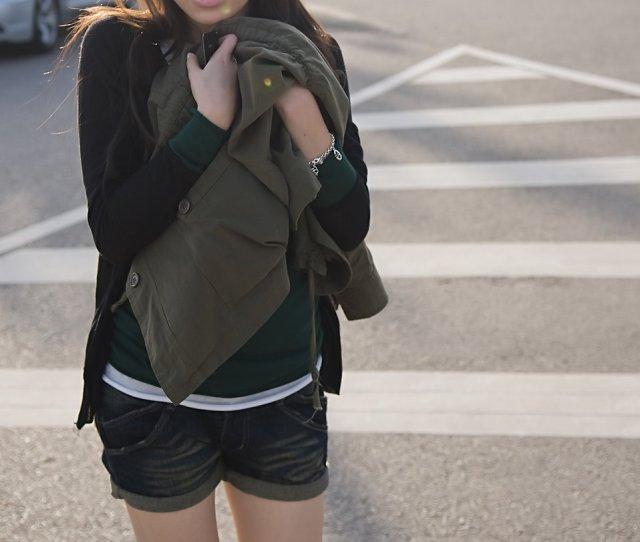 A Beautiful Chinese Girl Walking On A Street Free Stock Photo