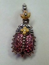 All of the tiny pave scarab charms are very difficult to find but the pink is probably the rarest.