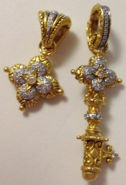 !8 and diamond signature flower enhancer and small key.