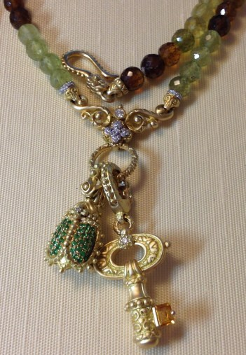 Grossular garnet necklace with tsavorite scarab and chubby key with citrine.