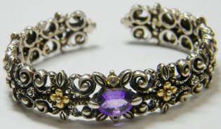 Amethyst cuff with less typical carved detail.