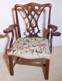 Signed EZ, I'm sorry I don't remember who made this beautiful Chippendale chair with its lovely fretwork and crewel embroidered seat.