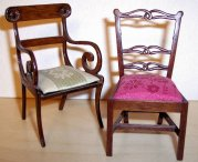 This unsigned Dun Phyfe side chair has gracefully curled arms and carving on the back. Ribbonback chair by Carol Hardy.