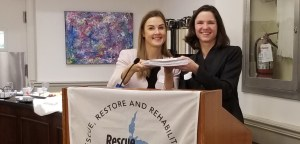 "RLSC Executive Director delivering petitions signed by 1000 people to Barrie-Innisfil MPP Andrea Khanjin, Parliamentary Assistant to the Minister of Environment, Conservation and Parks, at Queen's Park Breakfast Reception hosted by Rescue Lake Simcoe Coalition, ""Why Lake Simcoe Matters to All Ontarians."""