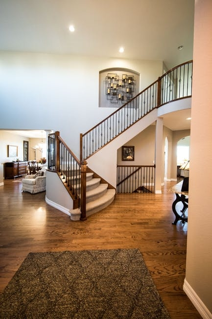How To Clean Carpeted Stairs   Carpeted Stairs To Wood   Brown Flooring   Wooden   Vinyl Plank   Middle Open Concept   Carpeting