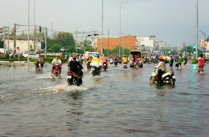 Residents in Ho Chi Minh City, Vietnam in the middle of flooding season. Flooding is just one of Vietnam's environmental challenges.
