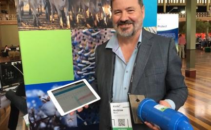 A man holding an ipad and a sensor