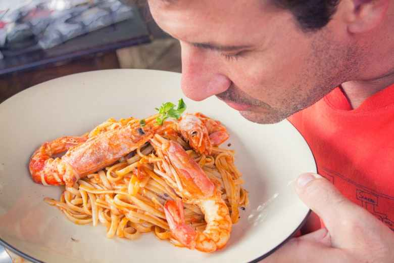 Man smelling plate of food