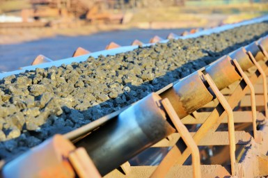 Crushed ore on a conveyor belt