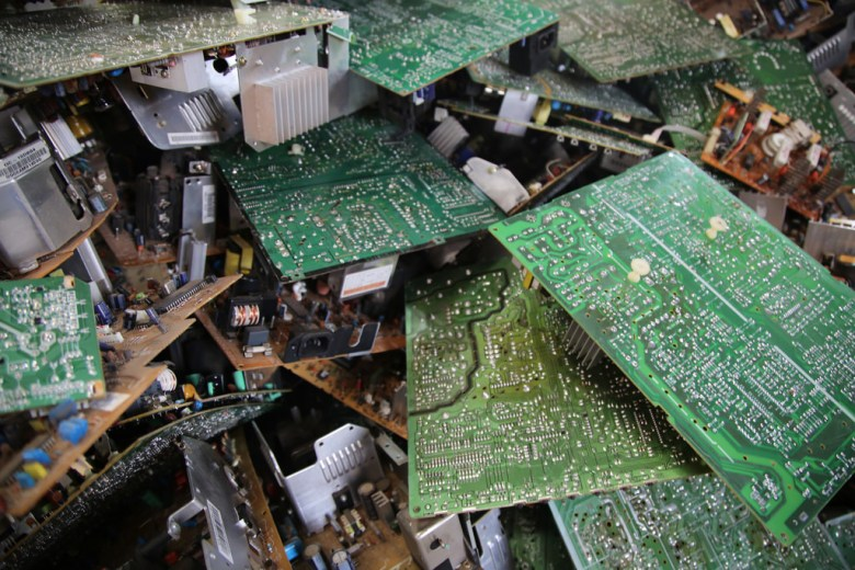 Pile of e-waste i.e. compter motherbiards and electronics components