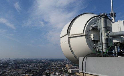 "A technological marvel aimed over the New Jersey skyline: ""the highest-performing E-band wireless radio in the world (throughput and latency), with the largest auto-steered E-Band antenna in the world""."