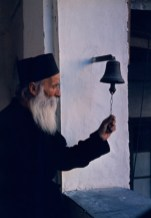 A monk ringing a small bell