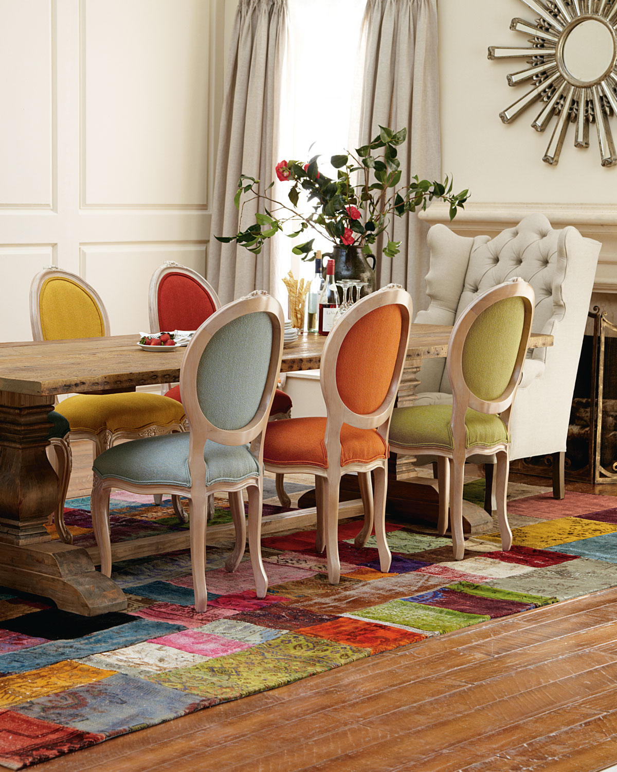 title | Dining room table with different colored chairs