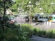 A tram rattles past