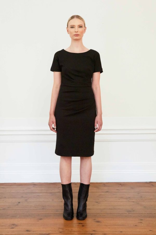 Girl wearing eve ecovero dress in color black
