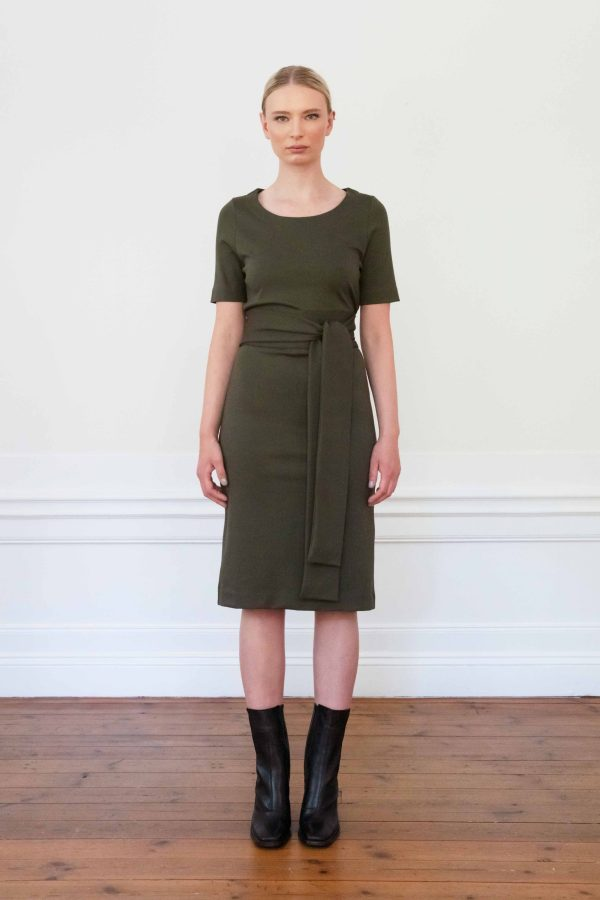 Girl wearing Lilith ecovero dress in color ink green
