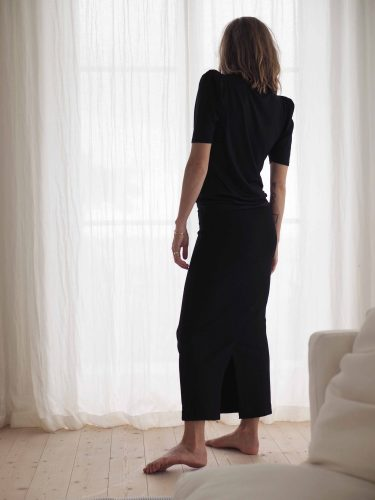 Girl wearing Luca tencel top black styled with Lala Ecovero skirt in black