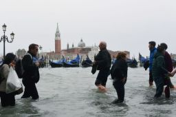 People walk in the flooded Riva degli Schiavoni in front of the San Giorgio church during a high-water (Acqua Alta) alert in Venice on October 29, 2018. - The flooding, caused by a convergence of high tides and a strong Sirocco wind, reached around 150 centimetres on October 29, 2018. (Photo by Miguel MEDINA / AFP)MIGUEL MEDINA/AFP/Getty Images