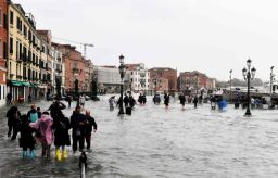 People walk in the flooded Riva degli Schiavoni during a high-water (Acqua Alta) alert in Venice on October 29, 2018. - The flooding, caused by a convergence of high tides and a strong Sirocco wind, reached around 150 centimetres on October 29, 2018. (Photo by Miguel MEDINA / AFP)MIGUEL MEDINA/AFP/Getty Images