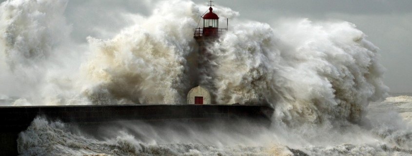Enormous waves enveloping lighthouse