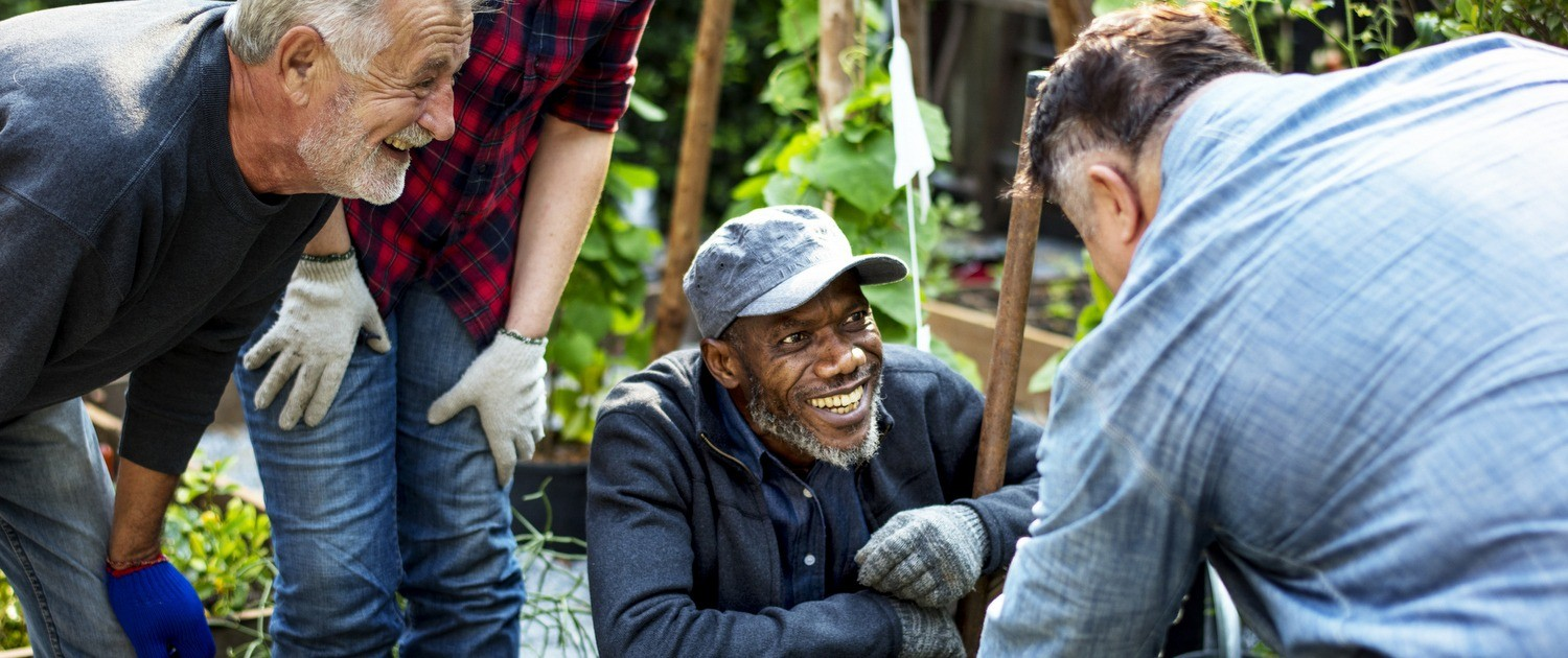 people smiling while gardening