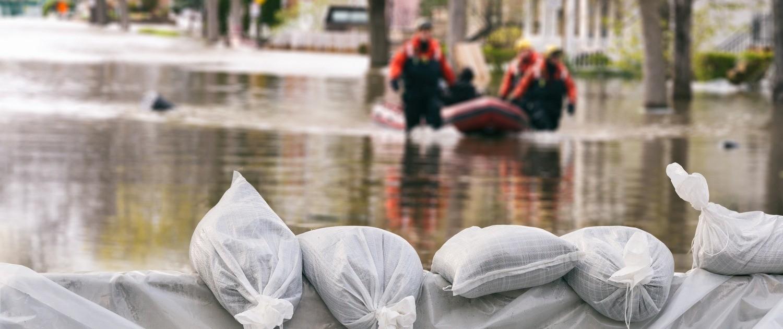 photo of flood with sandbags
