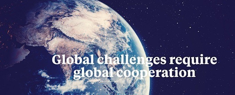Earth from space with words Global challenges require global cooperation