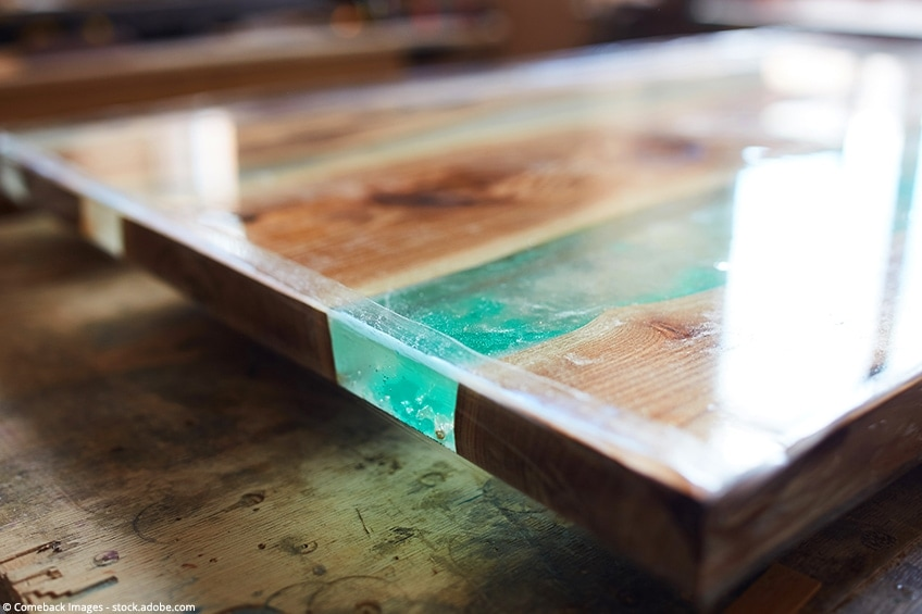 an epoxy resin river table with wood