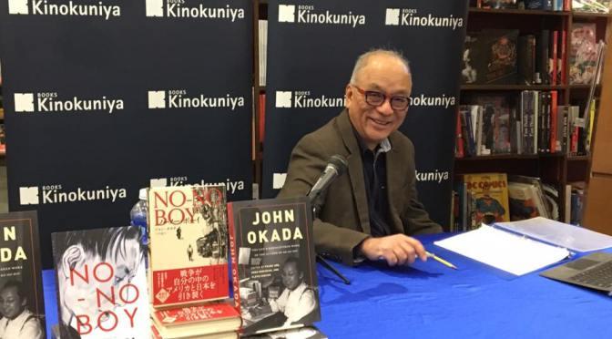 Frank Abe signing books