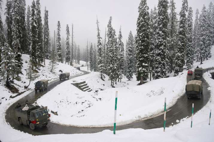 India Tv - Gulmarg: An army convoy moves on a snow covered road after the seasons first snowfall, at Gulmarg in Baramulla district of north Kashmir, Monday, Nov. 16, 2020. Authorities have issued an avalanche warning in four districts of the Valley as the higher reaches of the Union Territory received moderate to heavy snowfall, while the plains were lashed by rains.