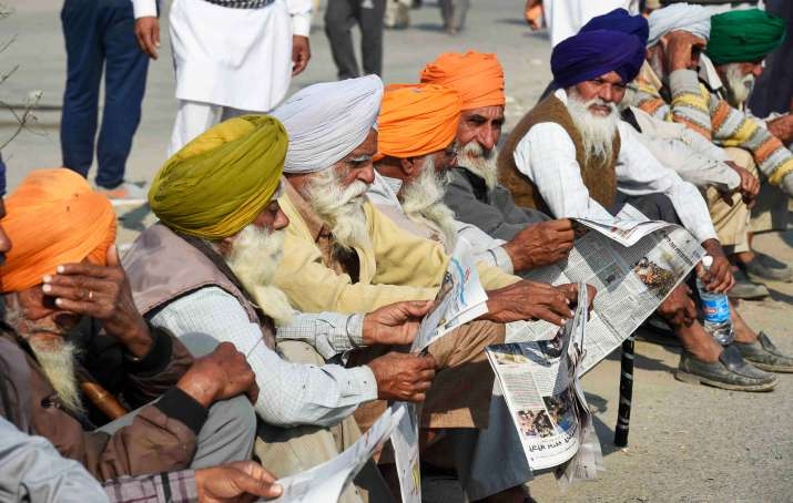 India Tv - New Delhi: Farmers read newspapers at Singhu border during their ongoing protest march Delhi Chalo against Centres new farm laws, in New Delhi, Sunday, Nov. 29, 2020.