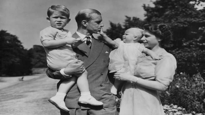 India Tv - In this Aug. 1951 file photo, Britain's Queen Elizabeth II, then Princess Elizabeth, stands with her husband Prince Philip, the Duke of Edinburgh, and their children Prince Charles and Princess Anne at Clarence House, the royal couple's London residence.