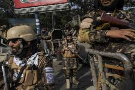 Taliban hang dead body in Afghanistan city's main square, says witness