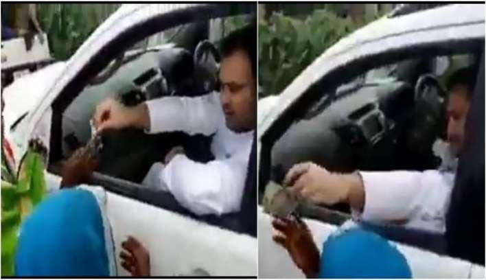 Tejashwi Yadav caught on cam distributing money ahead of