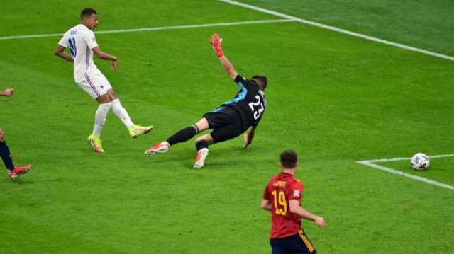 India Tv - Kylian Mbappe (in white) of France scores a goal by defeating Unai Simon of Spain during the UEFA Natio.