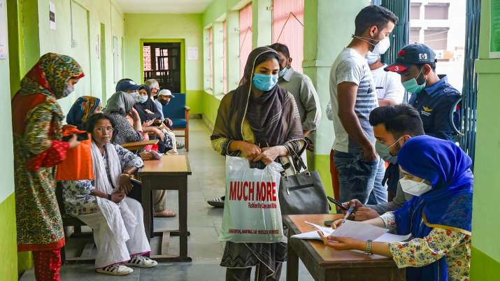 Teachers and students wait for a dose of COVID-19 vaccine