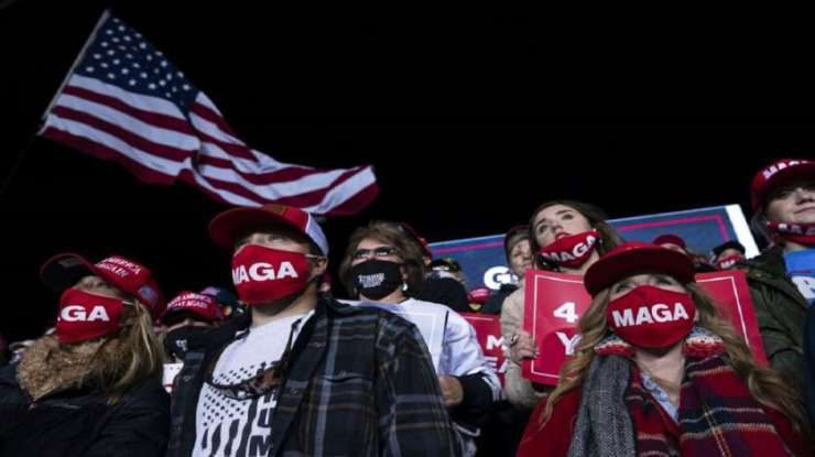 Supporters of President Donald Trump listen to him speak during a campaign rally at Richard B. Russell Airport in Rome.