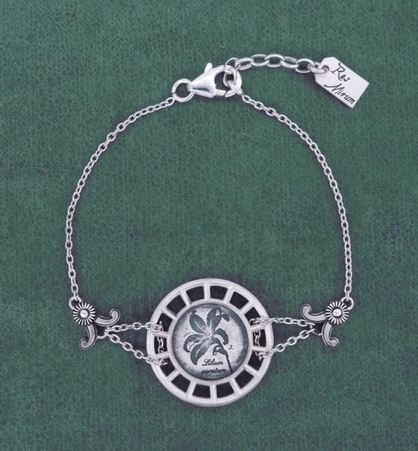 Bracelet rond à motif botanique de lys façon herbier dans un cadre d'inspiration architecture en argent de fabrication Française | Res Mirum