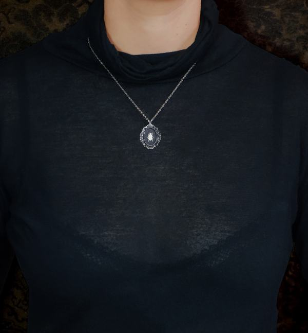 Small black egyptian beetle necklace in baroque oval frame inspired by handcrafted cabinets of curiosities worn | Res Mirum