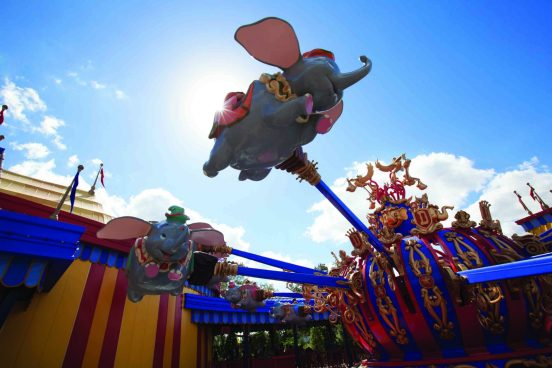 "Guests take a spin on ""Dumbo, the Flying Elephant"" at Magic Kingdom Park. With an unprecedented two Dumbos aloft, guests get to their flights faster aboard one of the park's most iconic attractions. Connecting the two Dumbos, a new ""big top"" area allows guests to immerse themselves in circus lore in a series of fun, interactive experiences before a spin with their favorite circus elephant. The double Dumbos help anchor the Storybook Circus area of New Fantasyland at Magic Kingdom Park — part of the largest expansion in Magic Kingdom history. (Disney)"