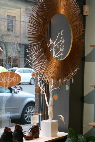 Gold Wreath hanging in re-souL shop window