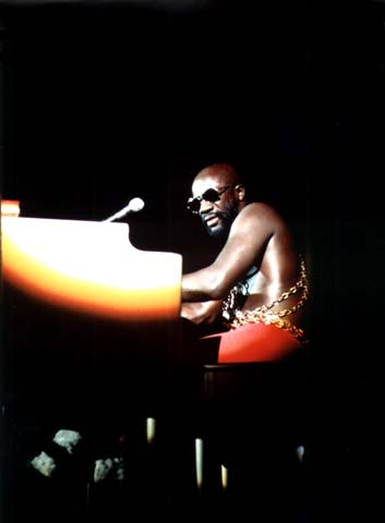 "© John H. White, ""Black soul singer Isaac Hayes performs at the International Amphitheater in Chicago as part of the annual PUSH [People United to Save Humanity] `Black Expo` in the fall of 1973,"" 1973"