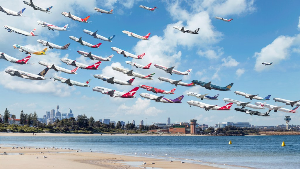 Sydney Kingsford Smith 34L Planes depart over Botany Bay and Sydney's Central Business District from Runway 34L at Syndey airport.