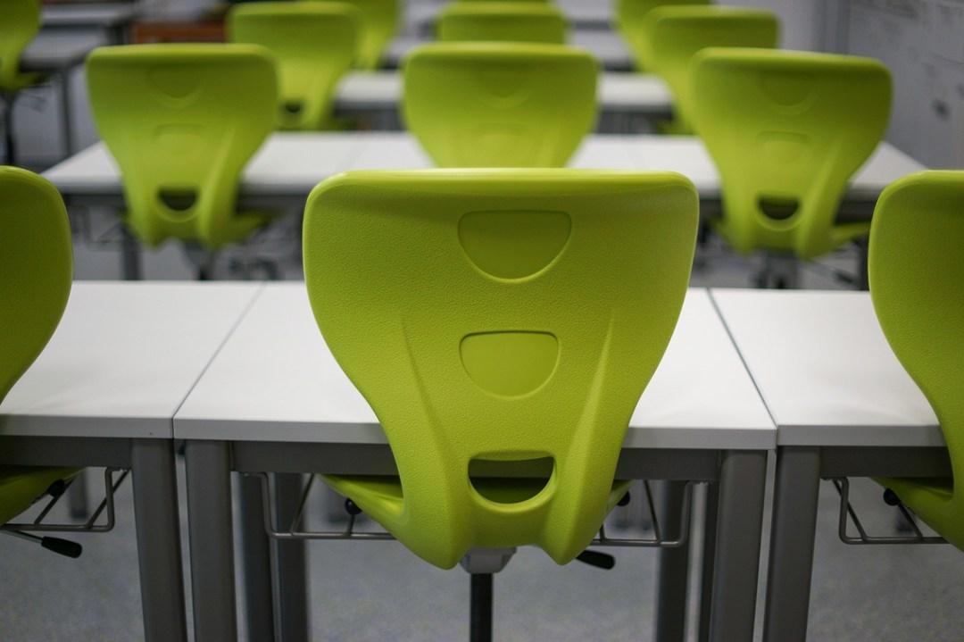 Green rolling classroom stools