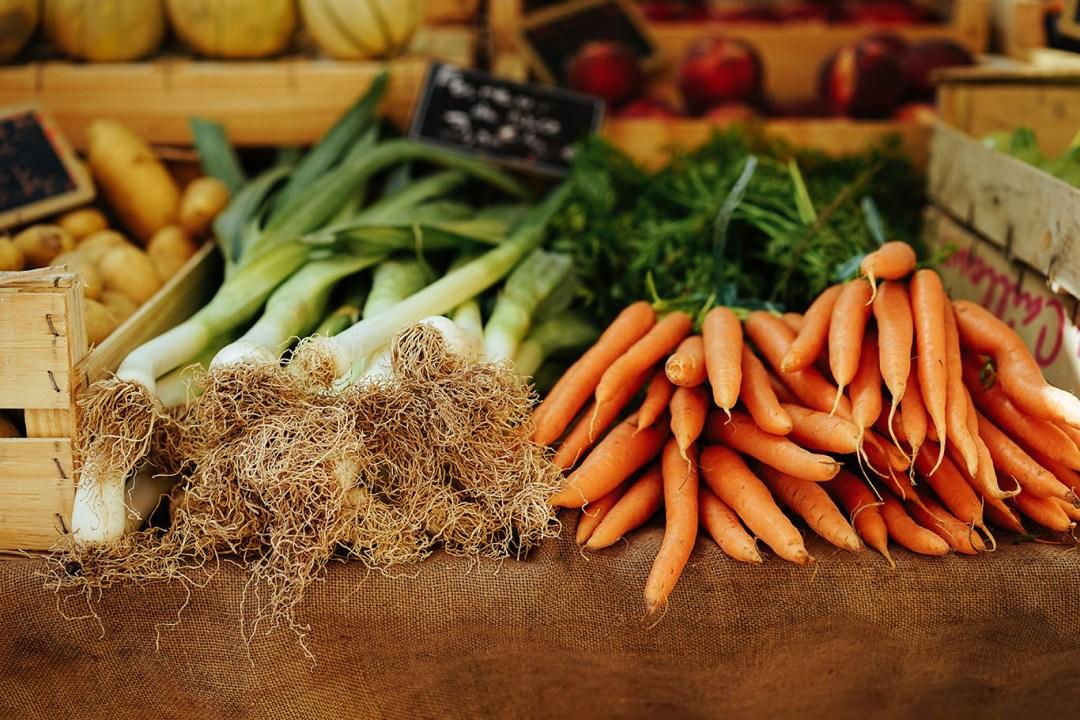 Fresh Produce Piled on Market Stand