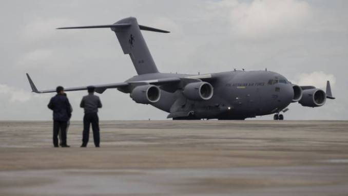 A Royal Australian Air Force (RAAF) C-17 Globemaster III transport plane carrying donated aid for Myanmar's flood victims lands at Yangon international airport in Yangon August 10, 2015. A C-17 has long been considered one of the options to replace the air force's aging Hercules, though there is only one left now available for purchase. Exactly what the replacement will be however, has not been outlined in the white paper.