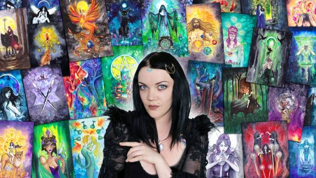 Jessica Shaw in front of a montage of some of her hand painted tarot cards.