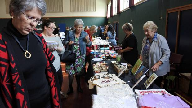 Members of the public browse Syrian items on display.